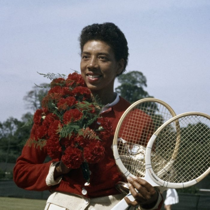 Althea Gibson Wins the French Open holding tennis rackets