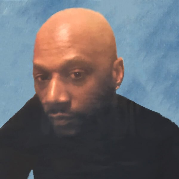 Daniel Prude picture on square blue background