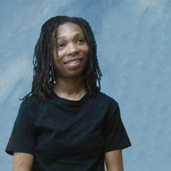 Janisha Fonville picture on square blue background